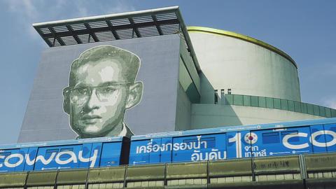 Bangkok - Sky train with portrait of His Majesty King Bhumibol Adulyadej, King RAMA IX. Bangkok Art Live Action