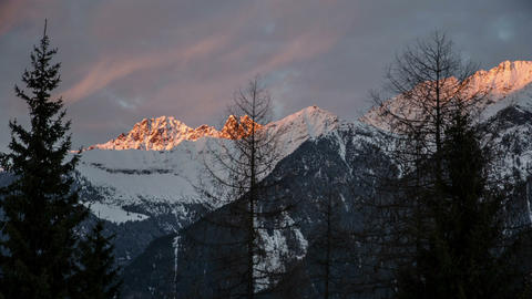 Sunset Evening Colors over Snowy Alps Mountains Time Lapse. Dolly Shot over Footage