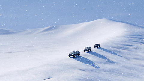 Offroad vehicle SUV on a snow slope at snowfall Footage