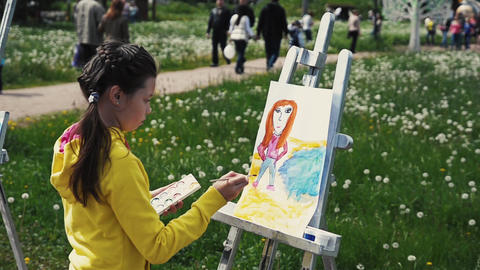 SAINT PETERSBURG, RUSSIA - SEPTEMBER 6, 2014: Little girl draws color picture on Footage