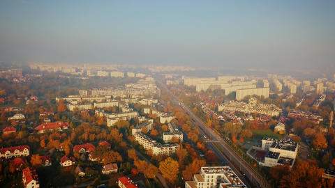 Beautiful cinematic aerial shot of misty sunrise in foggy town in autumn Footage