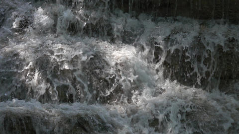 Streams of a waterfall closeup, slow motion ビデオ