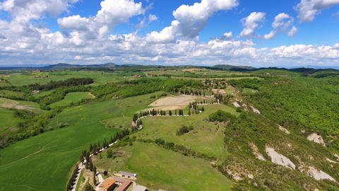 Tuscany aerial with road and cypresses on hills Footage