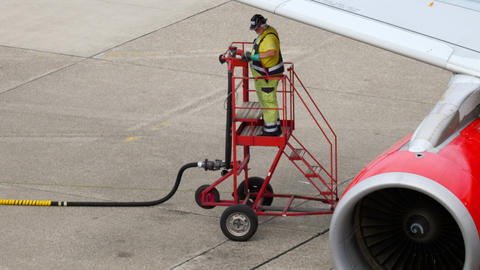 Airport worker refueling the aircraft Footage