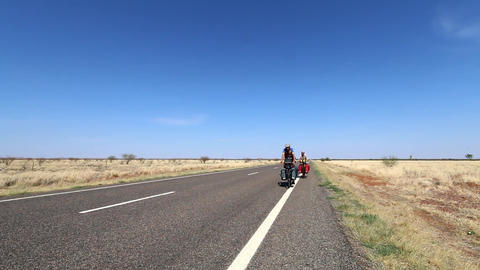 Two Cycling Travelers Go Along The Road In Plain Terrain (Short Clip) 영상물