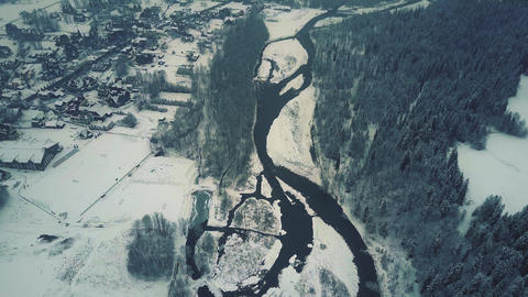 Aerial view of a forest, a small river and a typical Eastern European small town Footage