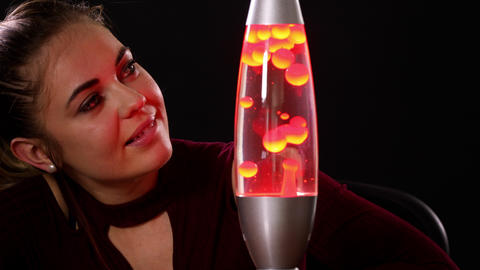 Pretty Woman Looking At A Lava Lamp Footage