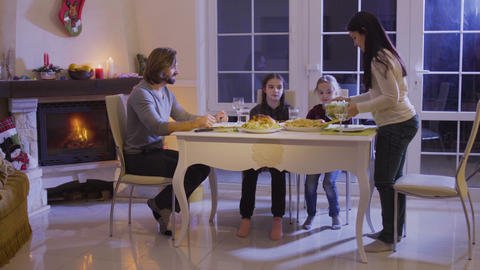 Happy family has a festive dinner at the christmas table Footage