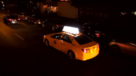 Yellow Cab driving through the night – MANHATTAN, NEW YORK/USA NOVEMBER 20, 20 Live Action