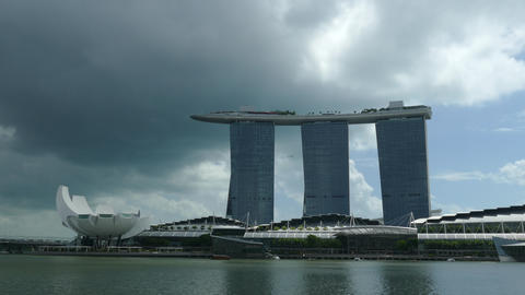 Time lapse from dark clouds moving over Marina Bay Sands Footage