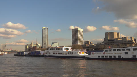 Sightseeing cruise on River Thames on a sunny day - LONDON,ENGLAND FEBRUARY 20,  Footage