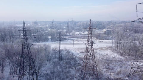 Aerial view of the power line near the railway in winter ビデオ