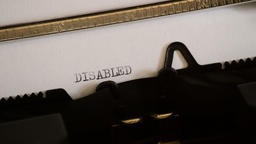Typing the word DISABLED with a old manual typewriter 영상물