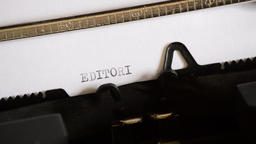 Typing the word EDITORIAL with an old manual typewriter Footage