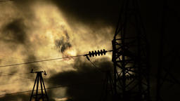 High voltage electrical tower in clear dark at sunset a cloudy day in timelapse Footage