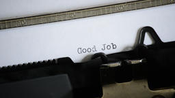 Typing the expression Good Job with an old manual typewriter 영상물