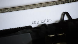 Typing the word OUR RULES with an old manual typewriter Footage