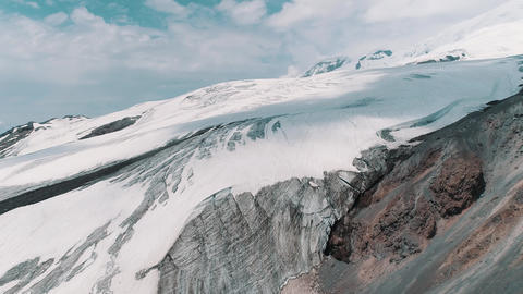 Aerial shot of astonishing nature snowy rocky mountain landscape Footage