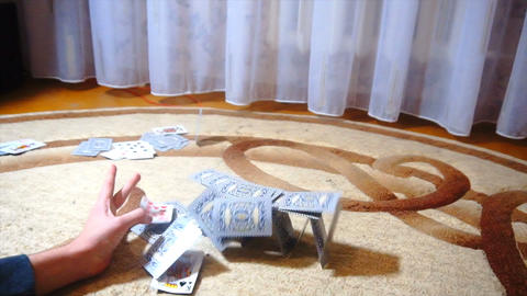 the young man destroys the house of cards, slow motion 영상물