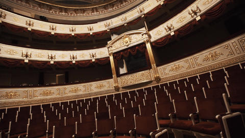 Expensive balcony in concert hall, empty chairs rows, red draipings Footage