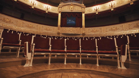 Luxurious balcony in concert hall, vacant chairs rows, red draipings Footage