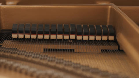 Wooden hammers hitting on strings, playing piano music Footage