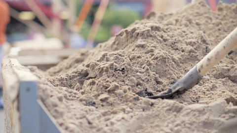 Shovel digging sand from large pile close up Live Action