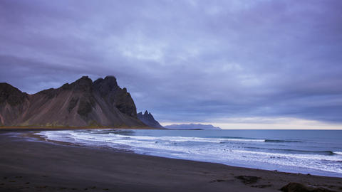 Time Lapse - Black Sand beach of the coastline with mountains in Iceland Footage