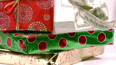 Cash falling on christmas gifts ビデオ