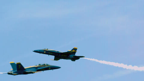 Blue angel streaks across sky turns into barrel roll Footage