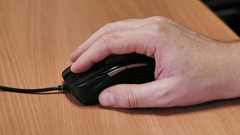 Man's hand using a wired computer mouse Footage