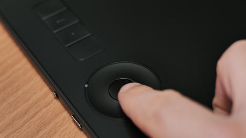 Man's hand pressing button on graphics tablet Footage