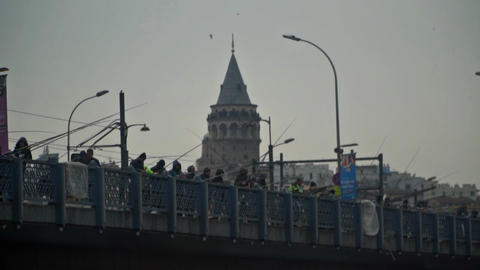 Slow motion shooting , Galata tower , galata bridge and fisherman Footage