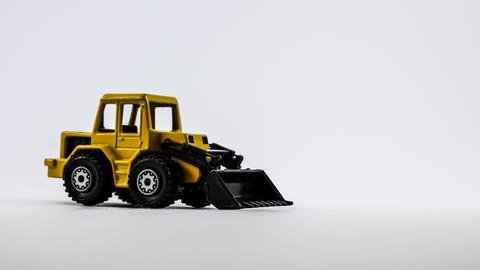 Machine loader isolated on a white backgound フォト