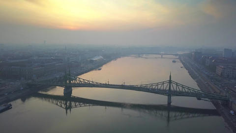 Aerial skyline view about drone flying over of Liberty Bridge at sunrise Footage