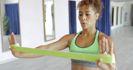 Sportswoman training with elastic band Footage