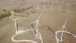 Windmills producing electricity in desert Footage