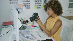Young woman exploring photos on camera Footage