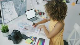 Pensive editor exploring photos Footage