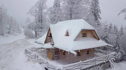 Wooden snowy house in woodland Footage