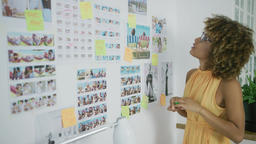 Stylish designer exploring photos Footage