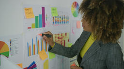 Woman drawing on charts Footage