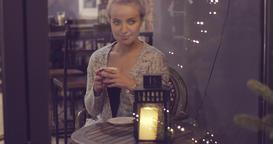 Dreamy woman drinking coffee Footage