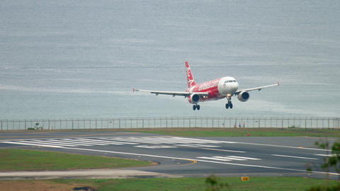 AirAsia Airbus A320 approaching over ocean Live Action