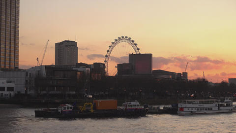 London skyline and London Eye after sunset - LONDON,ENGLAND FEBRUARY 20, 2016 Live Action
