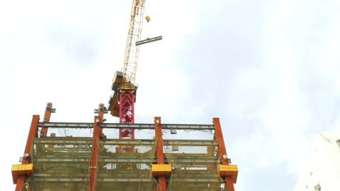 Tower Crane Swinging I Beam Around Front Logos Blurred stock footage