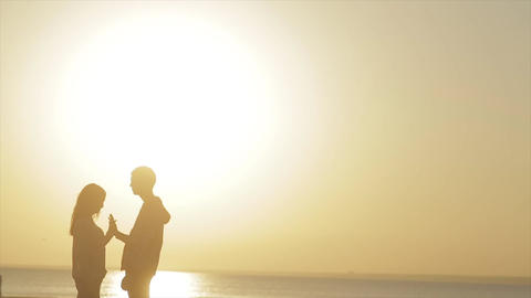 Silhouette Of Couple In Love On The Beach Footage