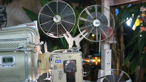 PHUKET THAILAND - MARCH 10, 2015: old film movie projector projecting playing at Footage