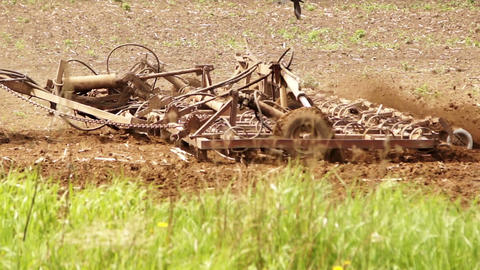 The plow cultivates the soil, close up Footage