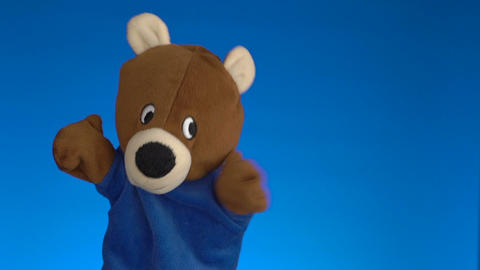 Teddy Bear Puppet Toy Over Blue Background stock footage